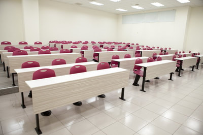 classroom system with auto-return chairs burgundy and fix table in Beirut