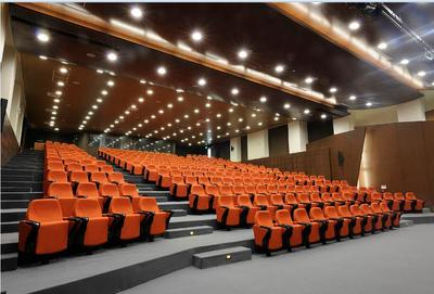 Orange auditorium chairs with folding tablet in Lebanon