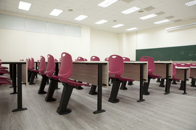training room with auto-return burgundy polypropylene chairs and fix table