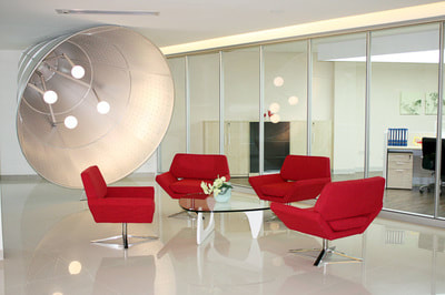 modern set of 4 petalo armchair in red fabric and glass center table for lounge area.