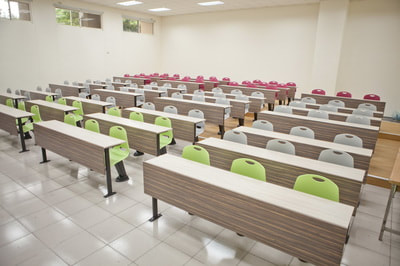 auditorium room with auto-return chairs colorful and fix table