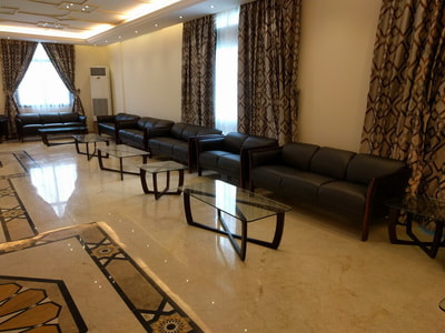 set of sofa black leather with neoclassic glass table for luxury reception